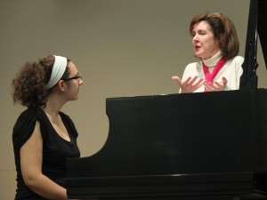master class instructor at piano with student
