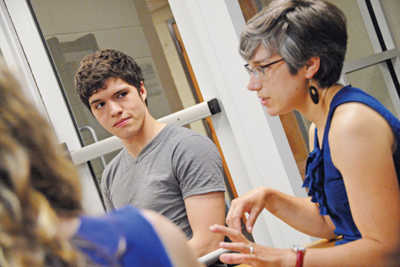 "Andrew Kile discusses his research project ""Creativity in Engineering"" with mentors Jean Pretz and Sara Atwood."